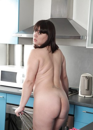 Thick brunette mom Belta posing nude in kitchen for homemade photos