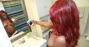 Amateur redhead Danielle taking selfies of natural black tits in bathroom