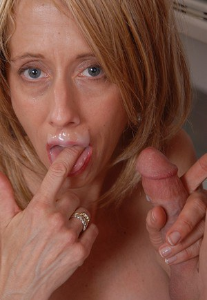 Experienced blonde dame Charlotte eating cum off of pink tongue