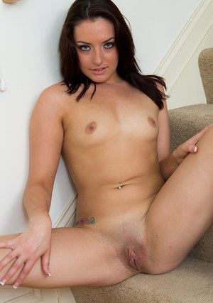 Amateur brunette model Nikki Lavay stripping down to pink bra and panties