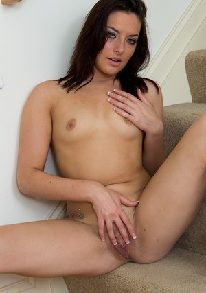 Young first timer Nikki Lavay exposing tiny tits and shaved snatch