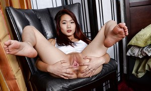 Asian spinner Lea Hart stretching pink pussy wide for clit exposure