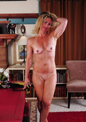 Chunky blonde dame Sydney stripping off dress and underthings to pose nude