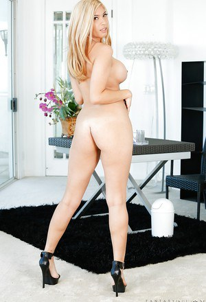 Cute blonde Gemma Jolie undresses to model nude in high heels only
