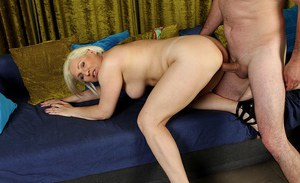 Mature short haired blonde Netty fingering pussy while giving blowjob