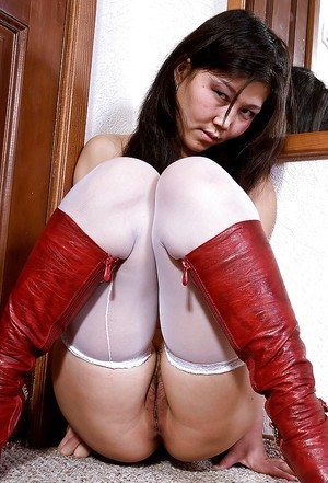 Japanese amateur Aksana posing seductively in white stockings and boots