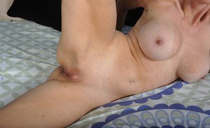 Experienced blonde dame Cameo baring large natural breasts in bedroom