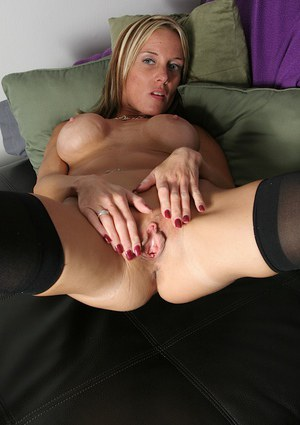 Stocking clad MILF Armani Knight sliding panties down legs for cunt viewing