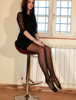 Leggy pantyhose clad model Emily posing non nude in skirt and heels