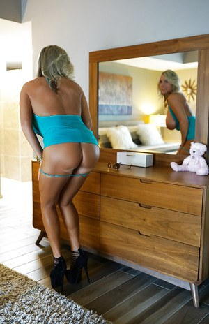 Busty blond wife Sandra Otterson posing non nude outdoors in sunglasses