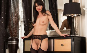 Mature Euro wife Roxanne Cox pulling lace panties aside to expose pussy