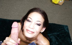 Naughty over 40 mom gets on her knees to jerk off a cock in the nude