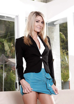 Leggy blonde Amanda Tate posing fully clothed in skirt and high heels