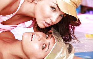 Young hottie Kim G and lesbian girlfriend don hats and eat pussy
