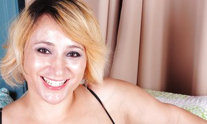 Short haired blonde plumper Jewels watches her tits escape from lingerie