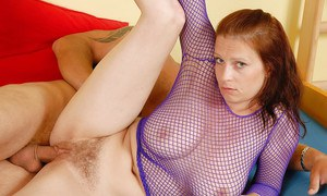 Chesty redheaded first timer Carol jerking cock while fingering hairy pussy