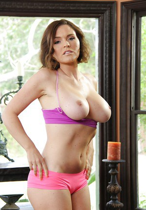 Busty MILF Krissy Lynn baring large tits while posing in pink undies