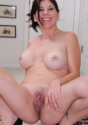 Nerdy mature dame Arden Delaney removing glasses and clothes to pose nude