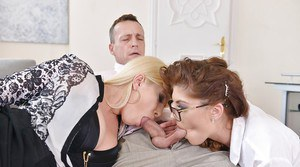 Fully clothed Euro chicks Bijou and Dona Bell sucking balls and cock
