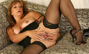 Mature blonde woman Bella Donna looking sexy in hose and garters