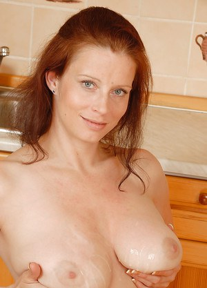 Busty amateur woman Carol takes a cumshot from husband on big natural tits