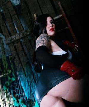 Tattooed cosplay model Yuffie Yulan exposing large all natural breasts