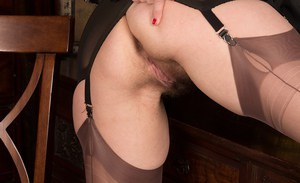Aged MILF Nikita flashing leg and garters underneath uniform