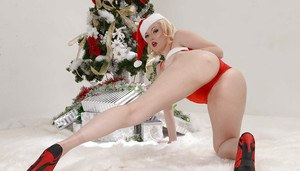 Blonde babe Jenna Ivory posing topless in Santa outfit for X-mas