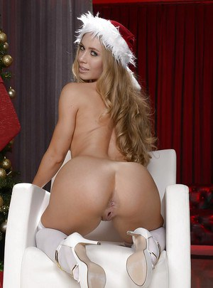 Hot blonde wife Nicole Aniston posing under X-mas tree in white lingerie
