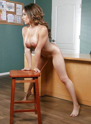 Chesty Latina babe Jean Michaels and her big breasts pose nude in classroom