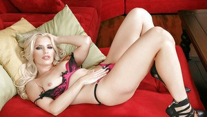Hot blonde mom Ashley Fires posing nude on couch in high heels