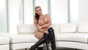 Masked blonde babe Phoenix Marie posing in over the knee black boots