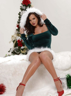 Sexy brunette babe Keisha Grey revealing big natural tits beside X-mas tree