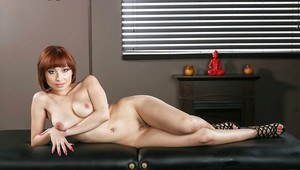 Short haired redhead Adessa Winters taking off her clothes for tease pics