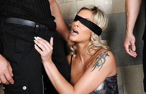 Blond babe Klarisa Leone is blindfolded for cock sucking action in washroom
