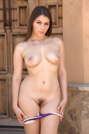 Beautiful brunette babe Valentina Nappi strips naked to toy trimmed pussy