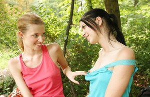 Young girls Angel I and Judy A explore lesbian side by having sex outdoors