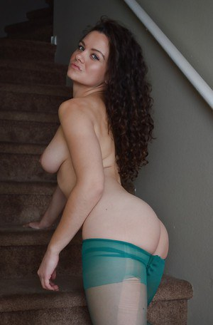 Solo chick Emily Ford struts fully clothed in ripped green pantyhose