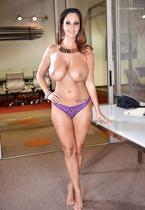 Buxom Latina MILF Ava Addams letting her big knockers loose at work