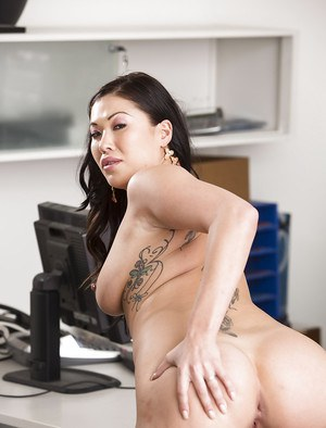 Gorgeous Asian pornstar London Keyes undressing to reveal shaved vagina