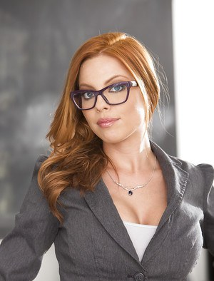 Redhead and glasses clad teacher Britney Amber baring bald cunt at school