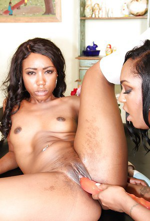 Dark skinned lesbians Layton Benton and Chanell Heart lick and toy twats