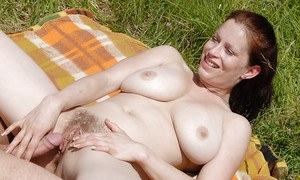 First timer Carol and her big hanging boobs giving a blowjob outdoors