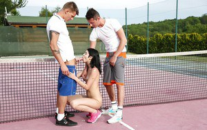 Teen slut Lady D gives two boys blowjobs outdoors on tennis court
