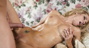 Blonde MILF pornstar Jessica Drake delivering a messy blowjob on her knees