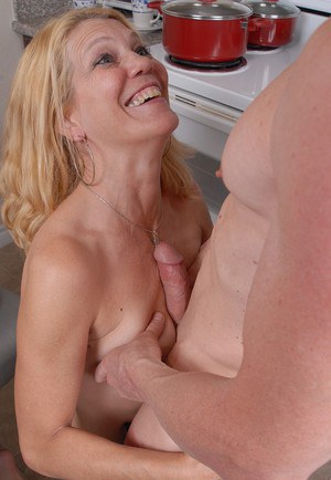 Older blonde housewife Lori is stripped naked by horny husband for sex