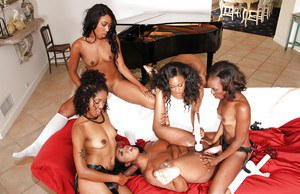 Black dykes Bella Doll and Layton Benton join girlfriends for lesbian orgy