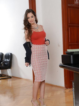 Hot French MILF modelling fully clothed in high heels, skirt and blazer