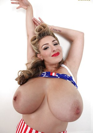 Chesty USA pinup babe September Carrino flaunting huge knockers