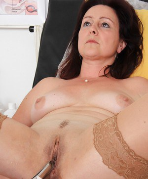 Mature woman Simi strips and spreads pussy for checkup with gyno doctor
